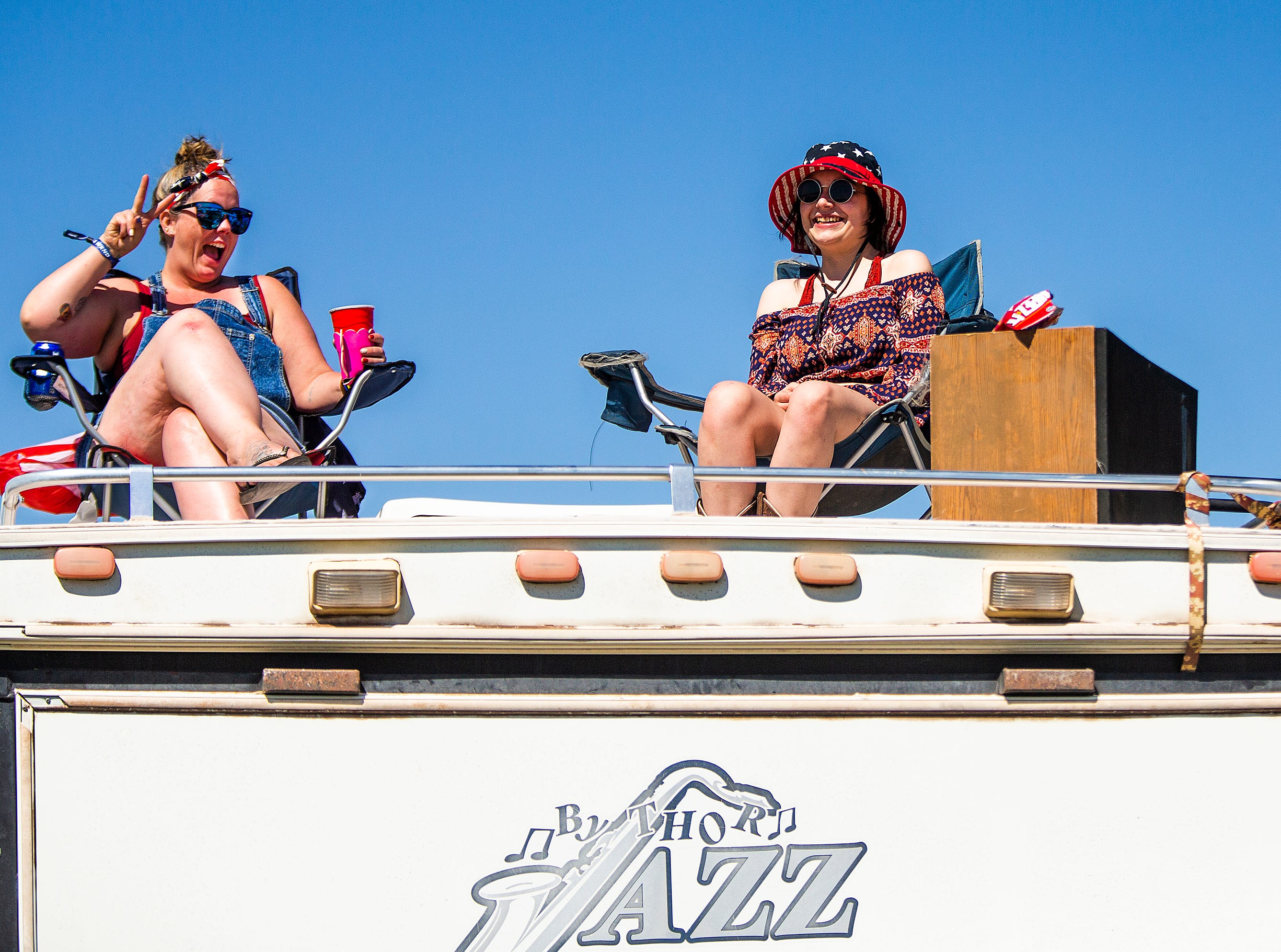 Brittany Shaw (left), 27, and her cousin Shai Hein, 21, of Payson, enjoy the view from atop their camper at the Country Thunder Arizona 2019 music festival April 11, 2019.