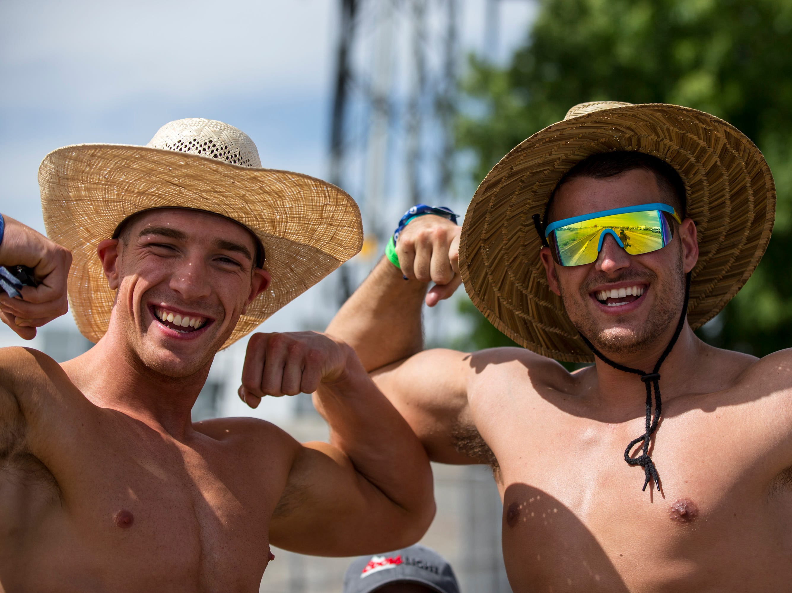 Ben Bachman (left) and Justin McBride flex for the camera on April 11, 2019, during Day 1 of Country Thunder Arizona in Florence.