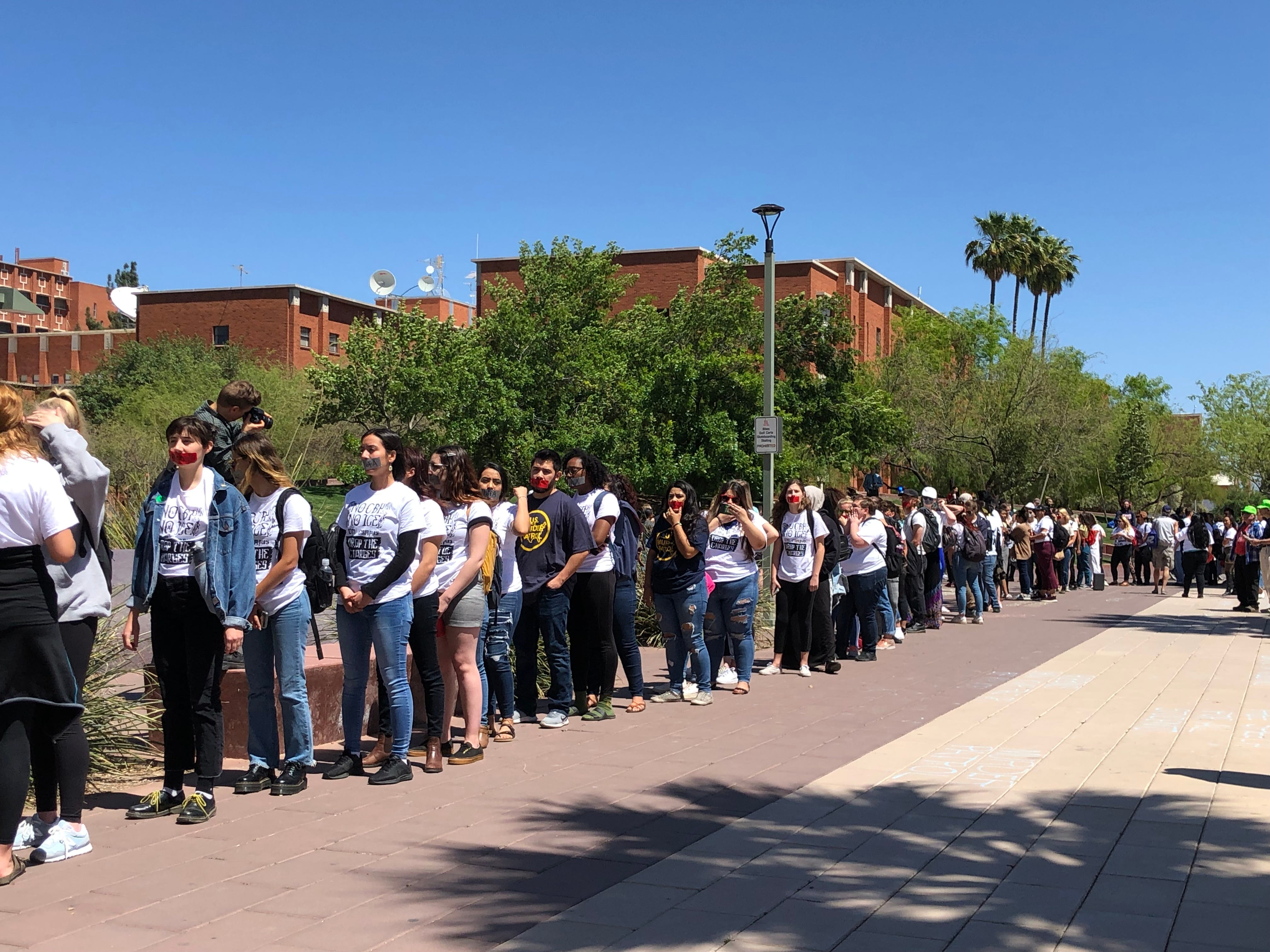 Students wait in line to get into the Arizona Board of Regents meeting on April 11, 2019, in Tucson to protest the charges against three students in the border patrol protest on March 19.