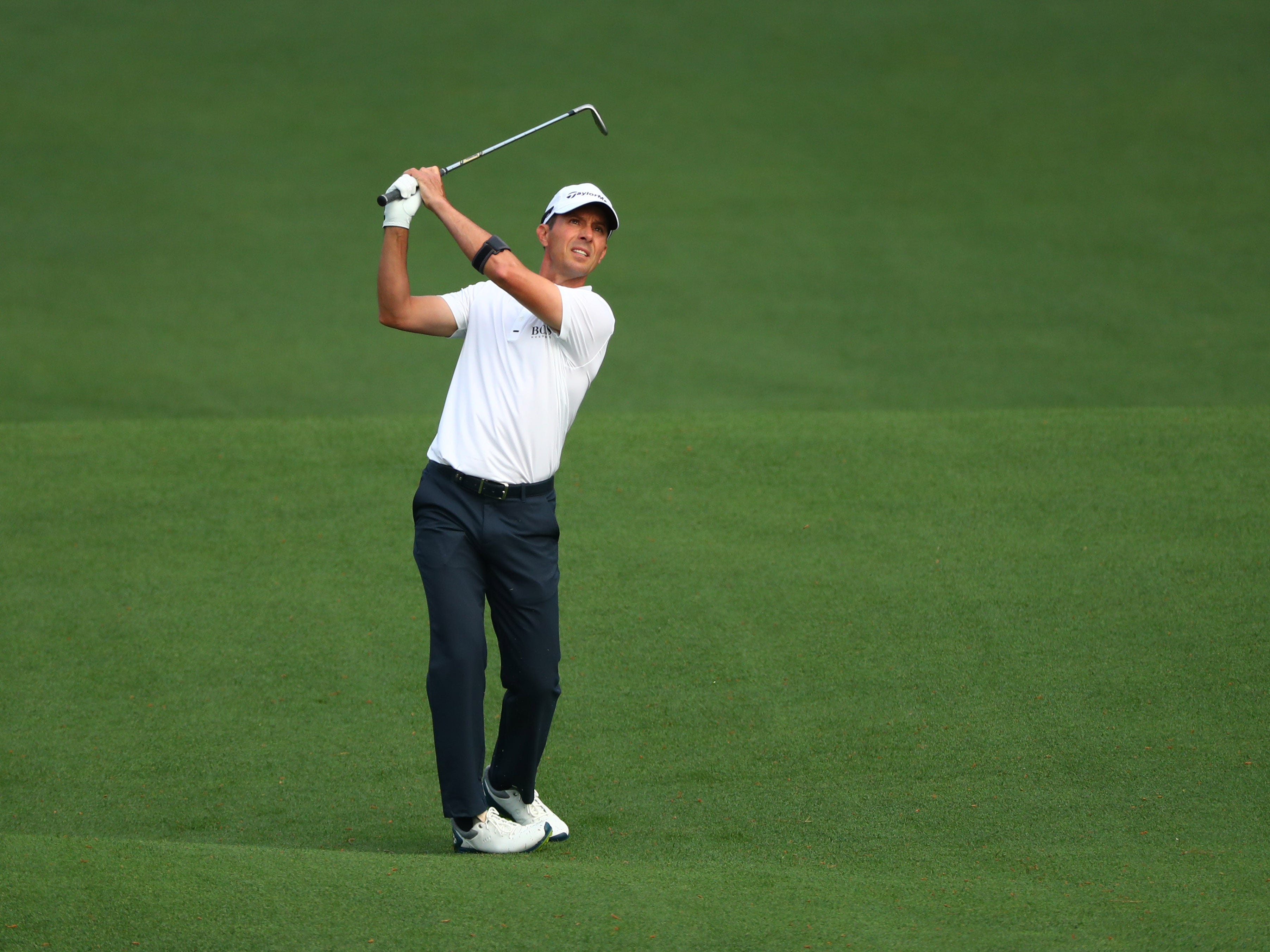Apr 11, 2019; Augusta, GA, USA; Mike Weir hits from the fairway on the 2nd hole during the first round of The Masters golf tournament at Augusta National Golf Club.
