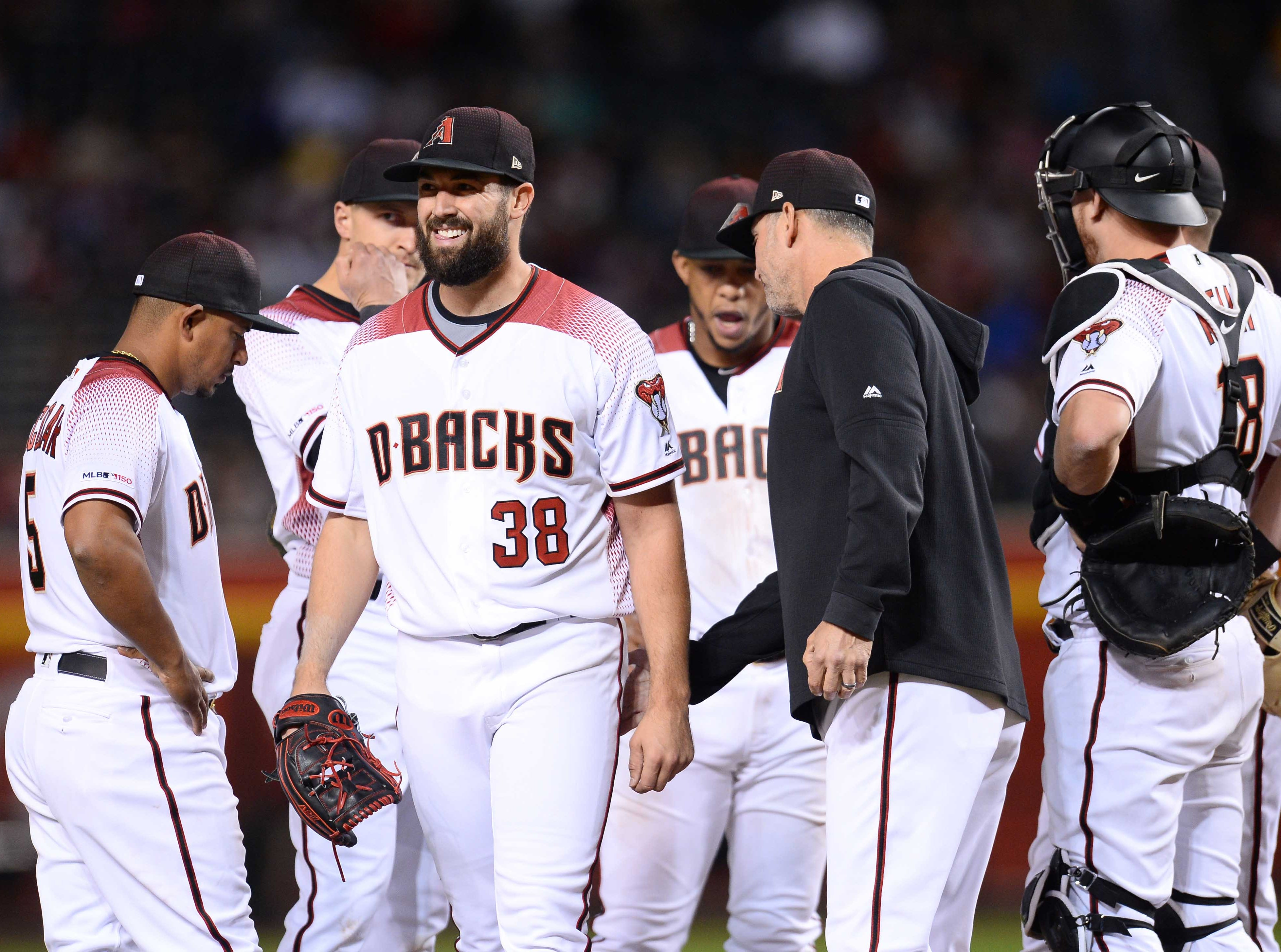 Apr 10, 2019; Phoenix, AZ, USA; Arizona Diamondbacks starting pitcher Robbie Ray (38) leaves the game against the Texas Rangers during the sixth inning at Chase Field. Mandatory Credit: Joe Camporeale-USA TODAY Sports