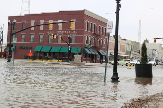 High water and flooding led to road closures in Ottawa and Sandusky counties on Thursday, such as the north end of Madison Street in downtown Port Clinton.