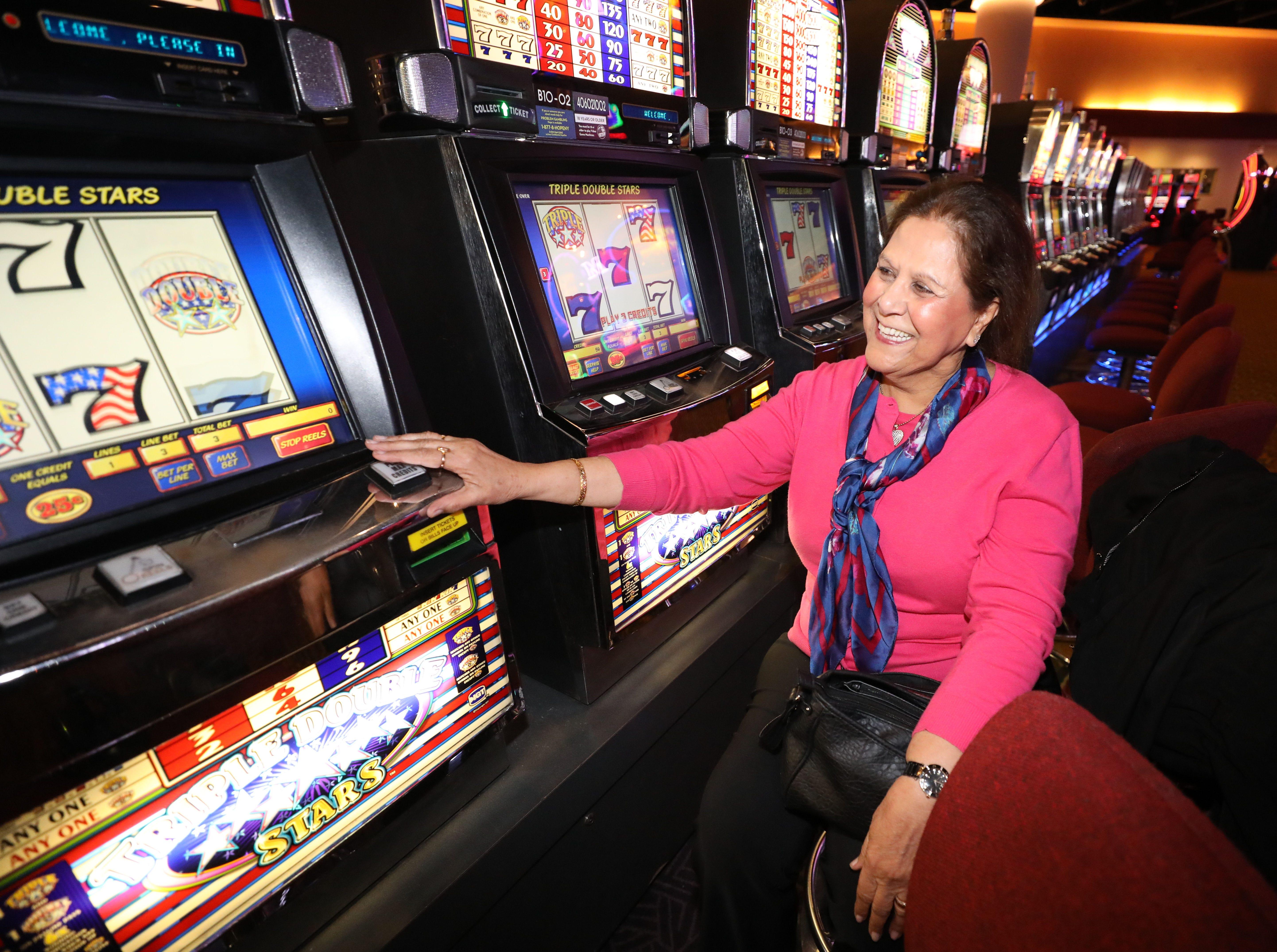 Birinder Singh plays her favorite video slot machine at the Monticello Casino Raceway in Monticello, April 10, 2019.