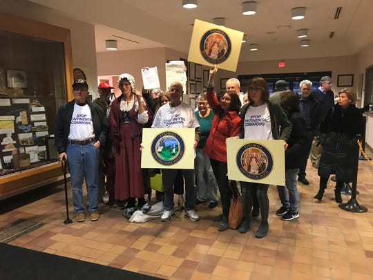 About a dozen people attended the Town of Fishkill planning board meeting Thursday in protest of the Continental Commons development on April 11, 2019.