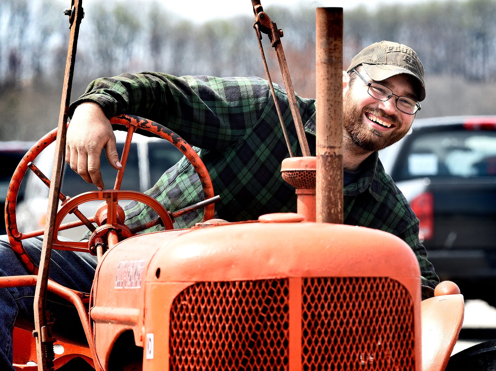 Spring Grove Area High School 2016 graduate Landon Heiner mans a classic tractor during the district's 6th Annual Rollin' Tractor Show on Thursday, April 11, 2019, presented by the Future Farmers Club. Alumni and area residents brought farm equipment to display with the goal of acquainting students with the agriculture industry. The show, which included a parade of equipment, visited the intermediate and elementary schools. Bill Kalina photo