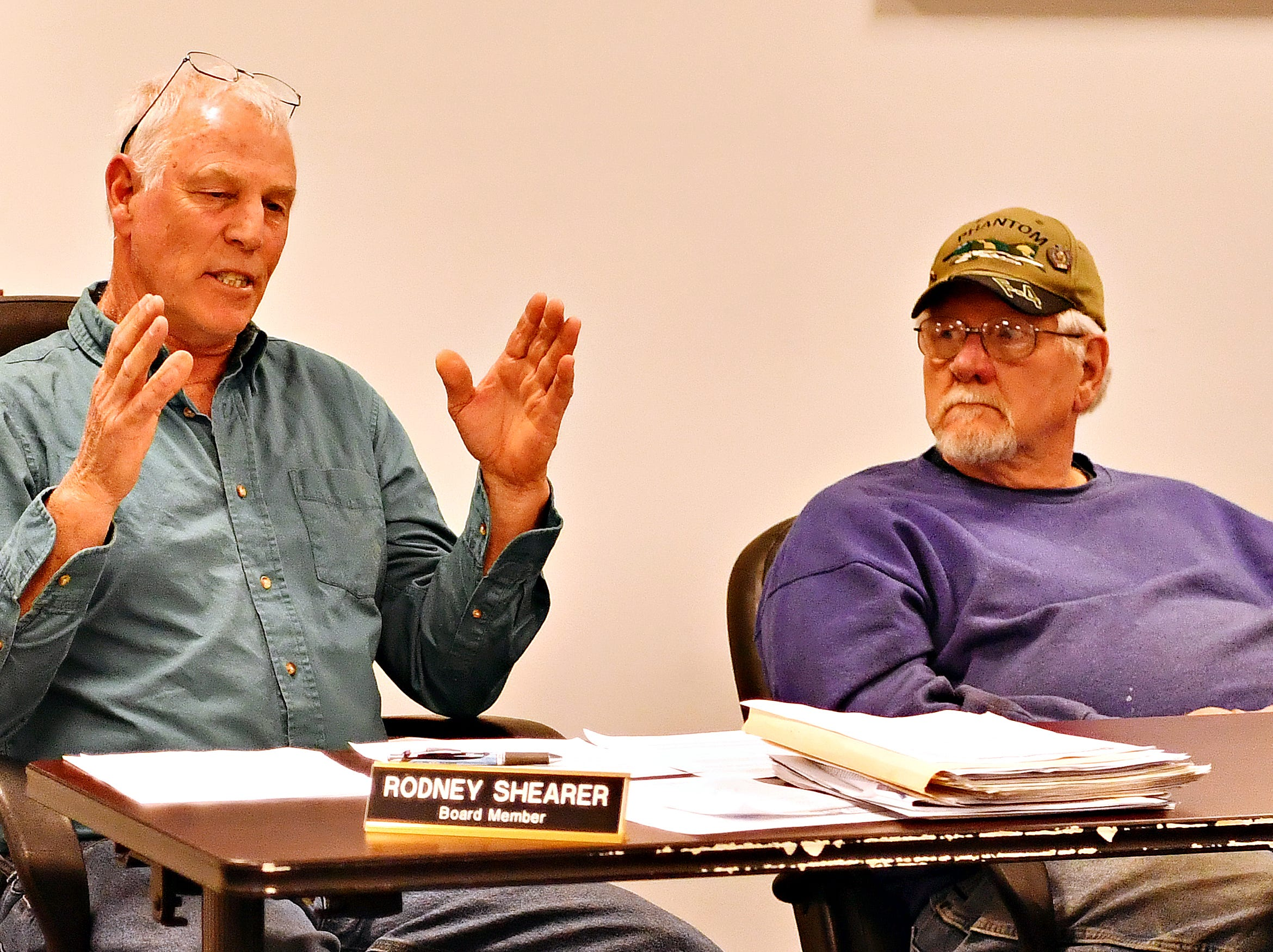 Rick Lint, right, looks on as fellow board member Rodney Shearer speaks during the Southwestern Regional Police Department's monthly board meeting at the station in Heidelberg Township, Wednesday, April 10, 2019. Dawn J. Sagert photo