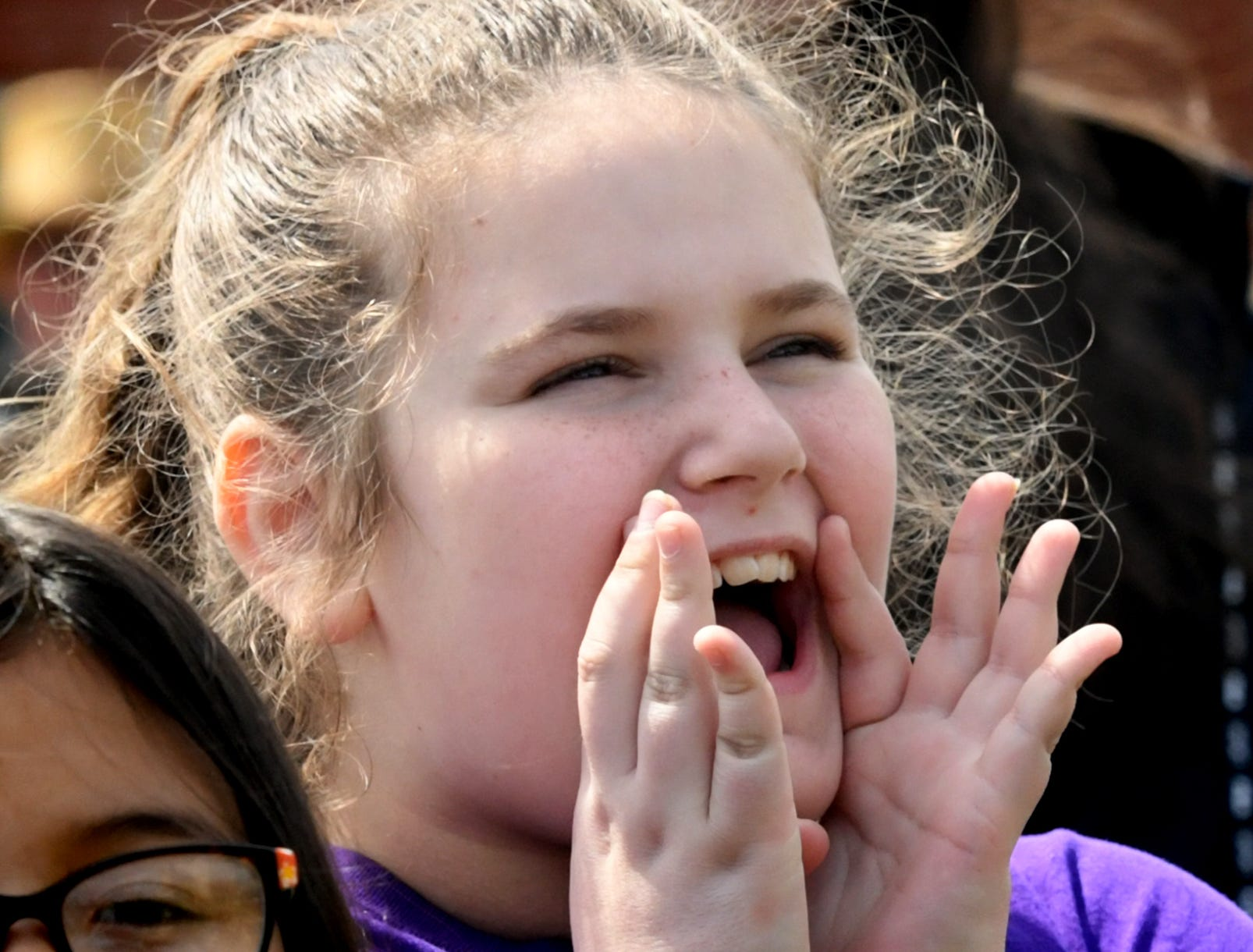 Spring Grove Elementary fourth grader Keiara Yohe participates in a demonstration during the district's 6th Annual Rollin' Tractor Show Thursday, April 11, 2019, presented by the Future Farmers Club. Alumni and area residents brought farm equipment to display with the goal of acquainting students with the agriculture industry. The show, which included a parade of equipment, visited the intermediate and elementary schools. Bill Kalina photo