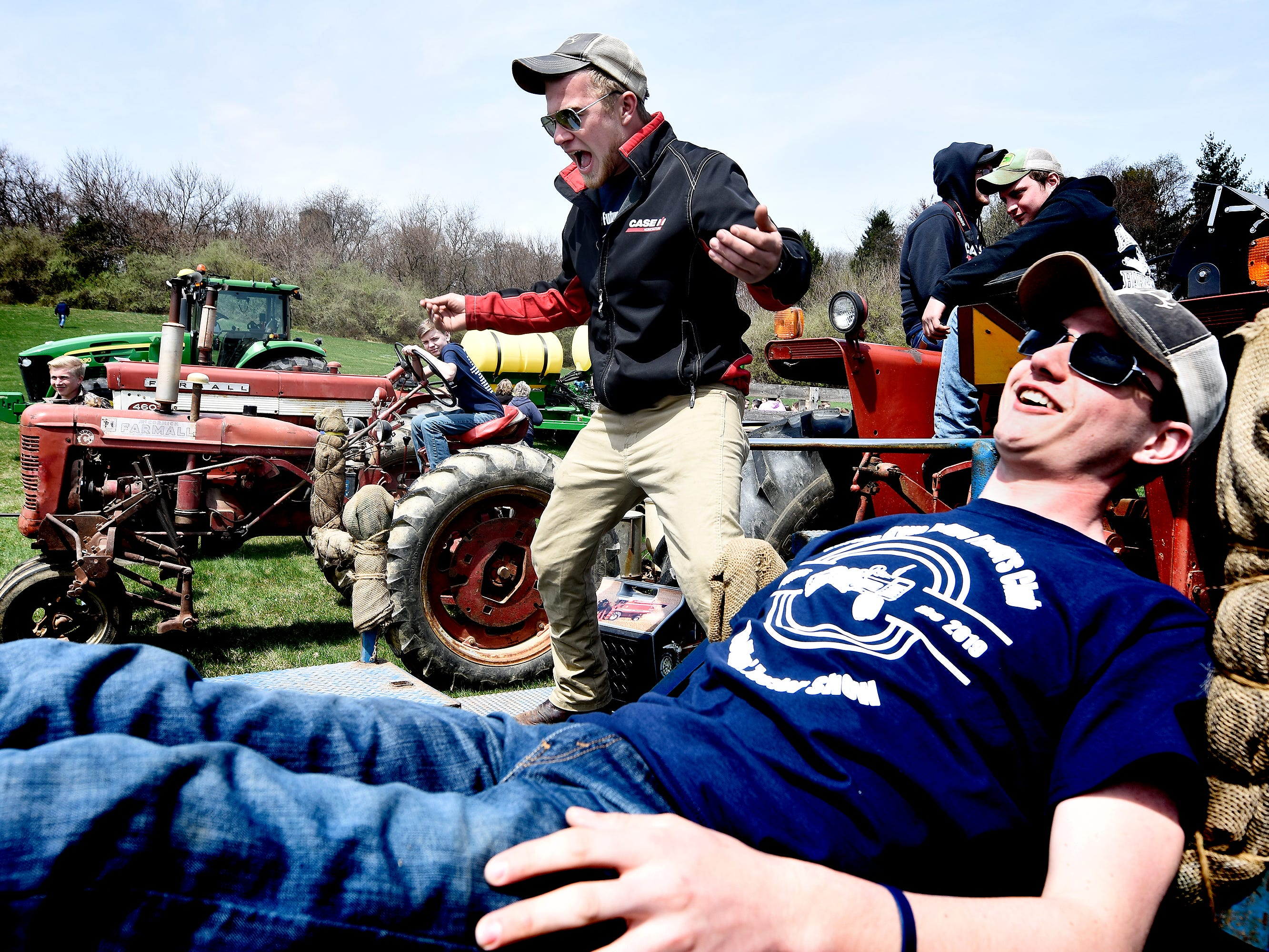 Spring Grove Area High School 2016 graduate Caleb Barshinger, left, and high school junior Sean Rickrode give a presentation on tree planting during the district's 6th Annual Rollin' Tractor Show on Thursday, April 11, 2019. The show is presented by the Future Farmers Club. Alumni and area residents brought farm equipment to display with the goal of acquainting students with the agriculture industry. The show, which included a parade of equipment, visited the intermediate and elementary schools. Caleb's family farm, Barshinger Produce, Codorus Township, participated in the show. Bill Kalina photo