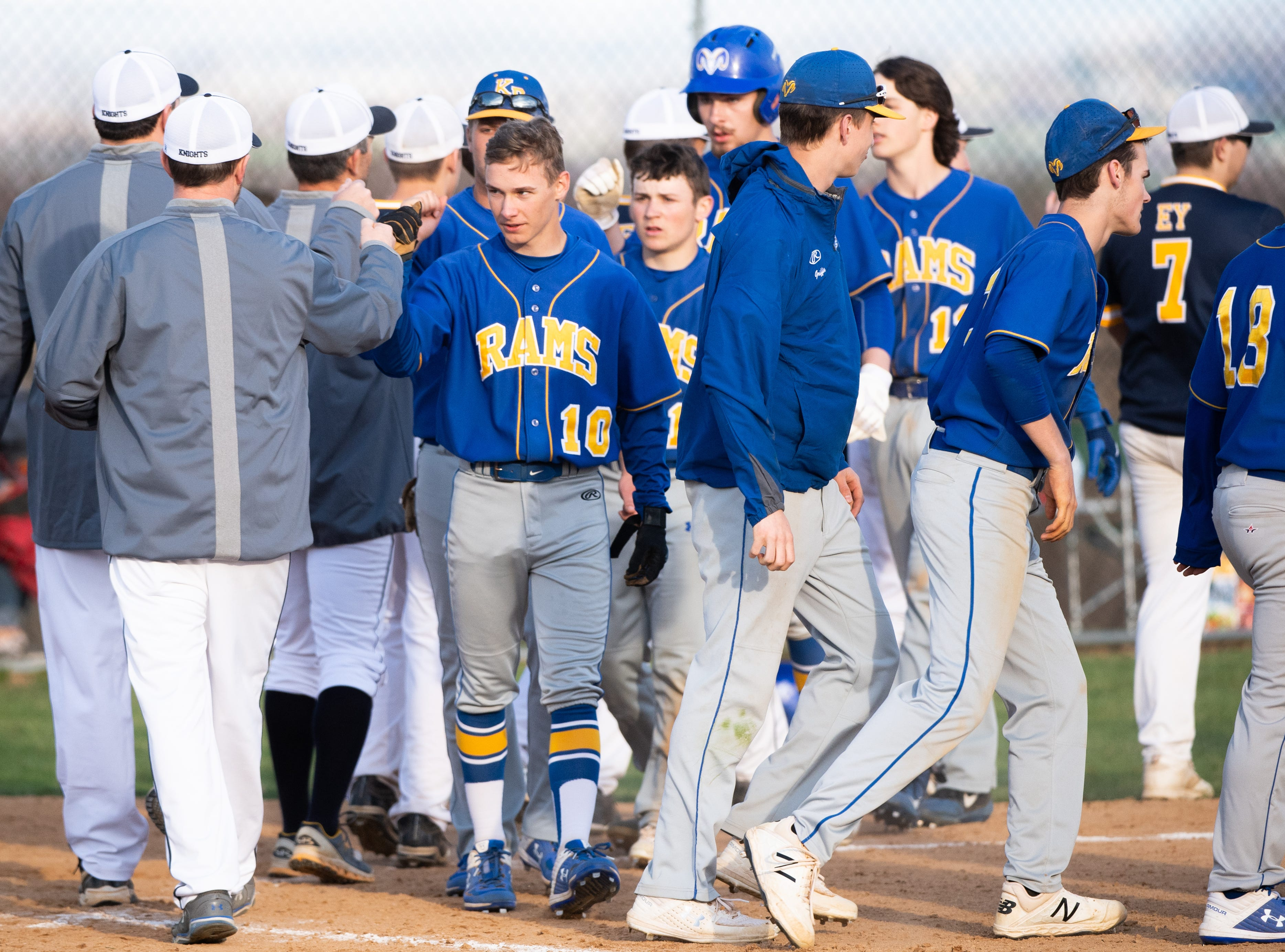 Kennard-Dale and Eastern York shake hands after a tough game, April 10, 2019. The Golden Knights defeated the Rams 8 to 1.