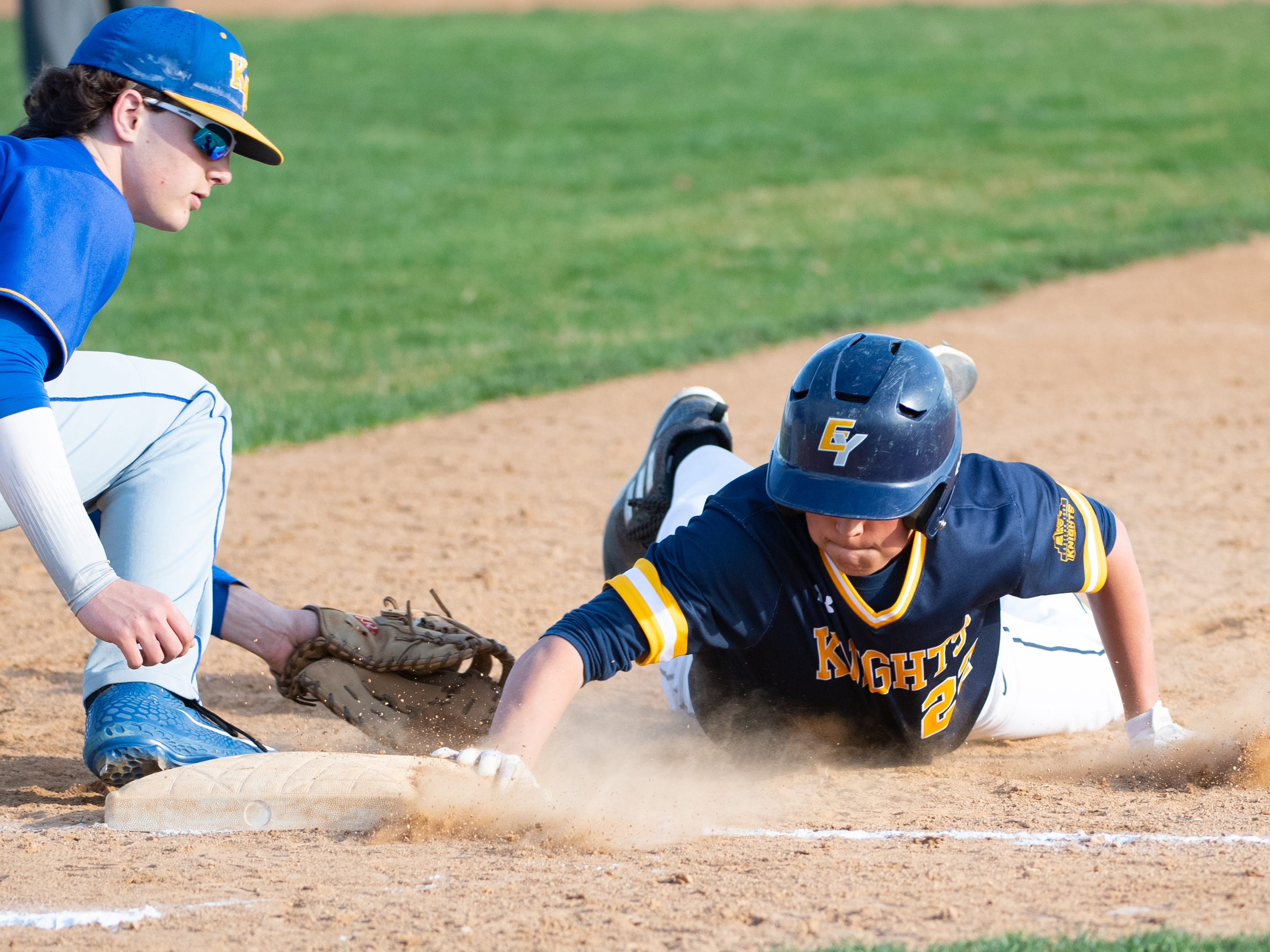 Justin Ranker (22) slides to first base during the baseball game between Eastern York and Kennard-Dale, April 10, 2019 at Eastern York High School. The Golden Knights defeated the Rams 8 to 1.