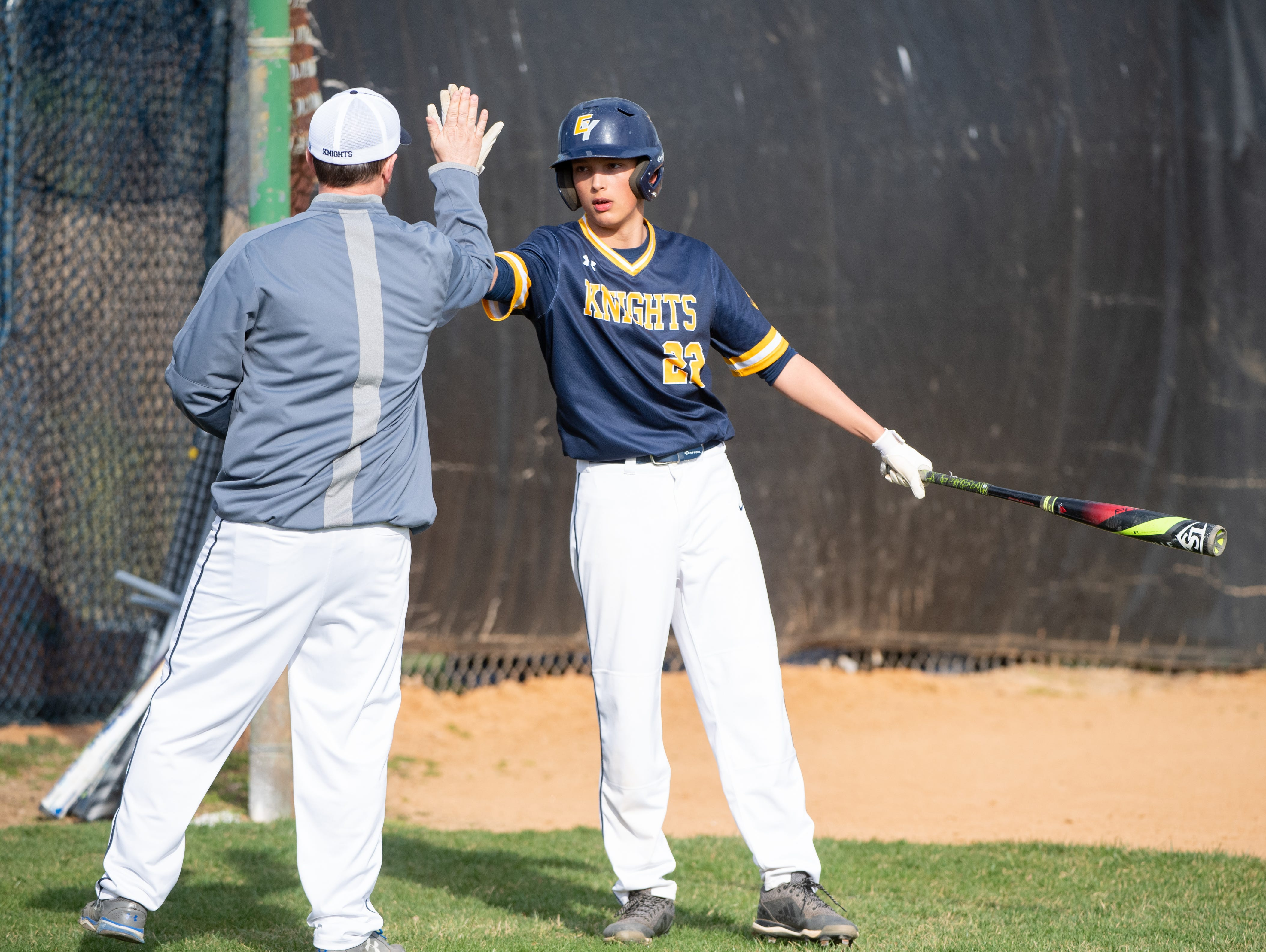 Justin Ranker (22) high-fives his coach during the baseball game between Eastern York and Kennard-Dale, April 10, 2019 at Eastern York High School. The Golden Knights defeated the Rams 8 to 1.