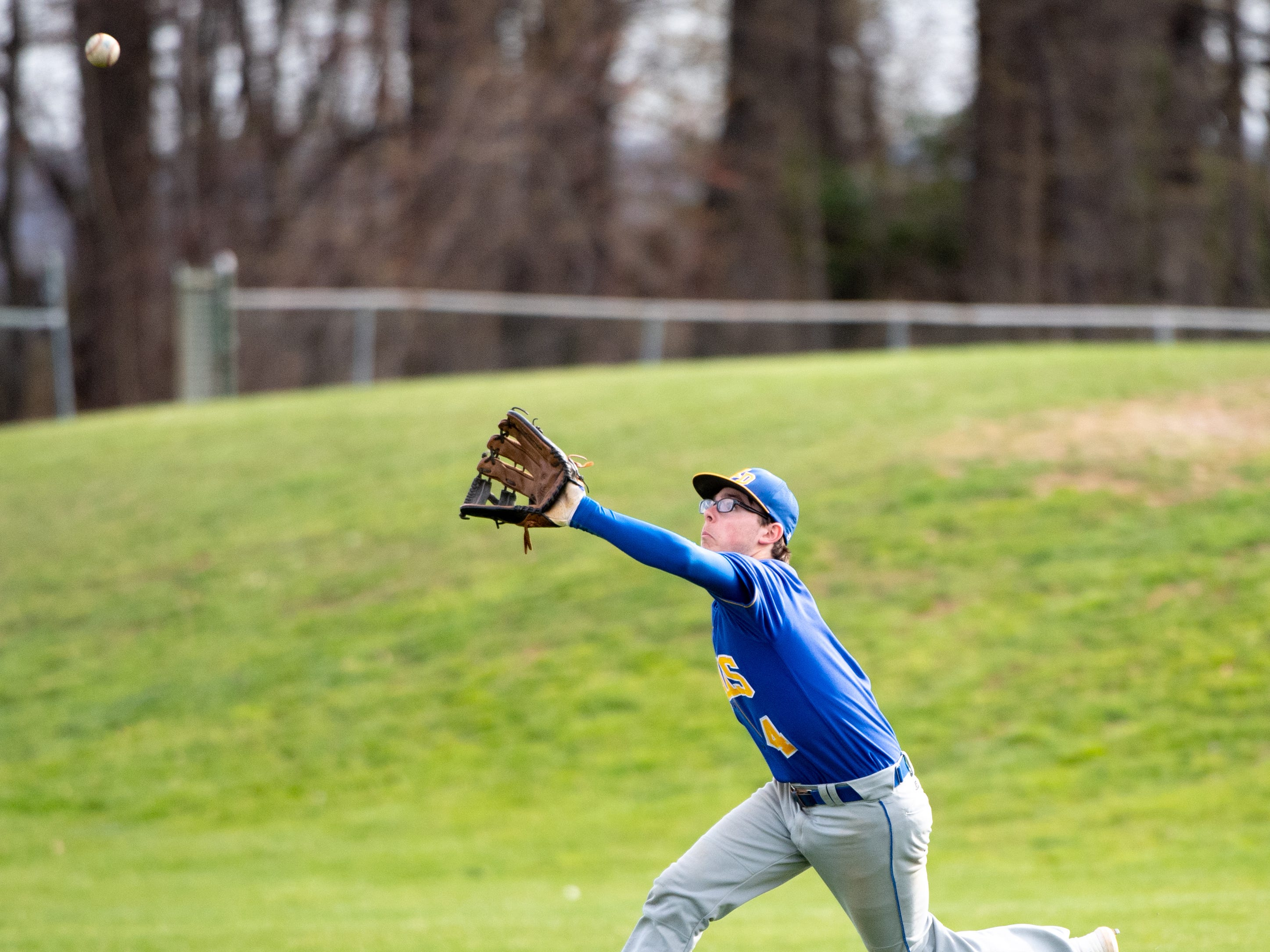 Jason Williams (4) looks to make the catch in the outfield during the baseball game between Eastern York and Kennard-Dale, April 10, 2019 at Eastern York High School. The Golden Knights defeated the Rams 8 to 1.