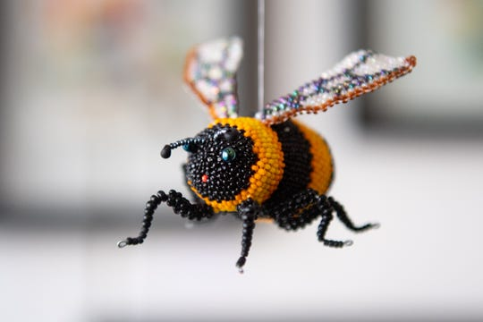 A beaded bee by co-owner Karen Paust on display in Venture in downtown York. Venture is part of the Parliament Arts Organization in the Royal Square District,  April 11, 2019.
