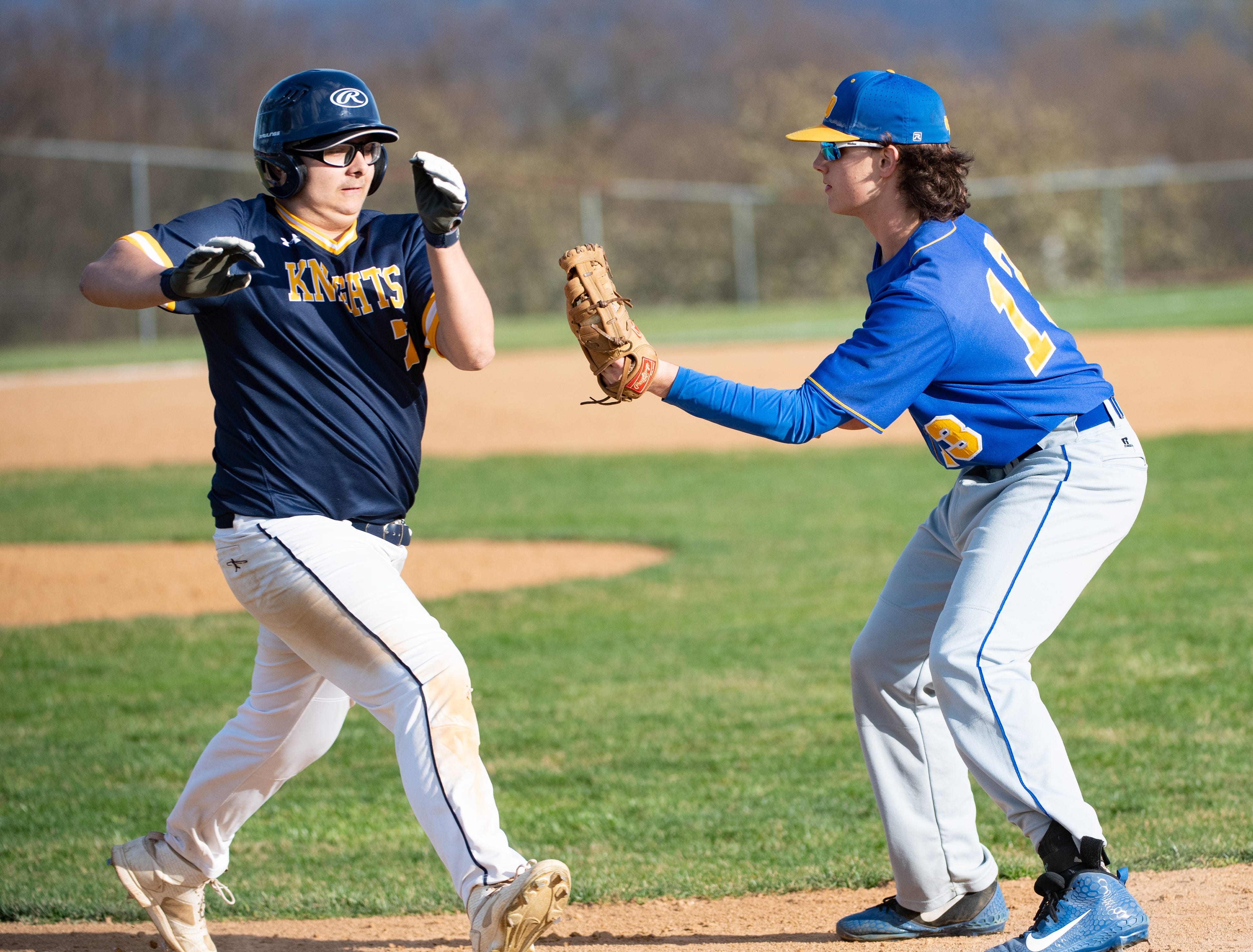 Ryan Schubert (13) tags out Quinton McNew (7) during the baseball game between Eastern York and Kennard-Dale, April 10, 2019 at Eastern York High School. The Golden Knights defeated the Rams 8 to 1.