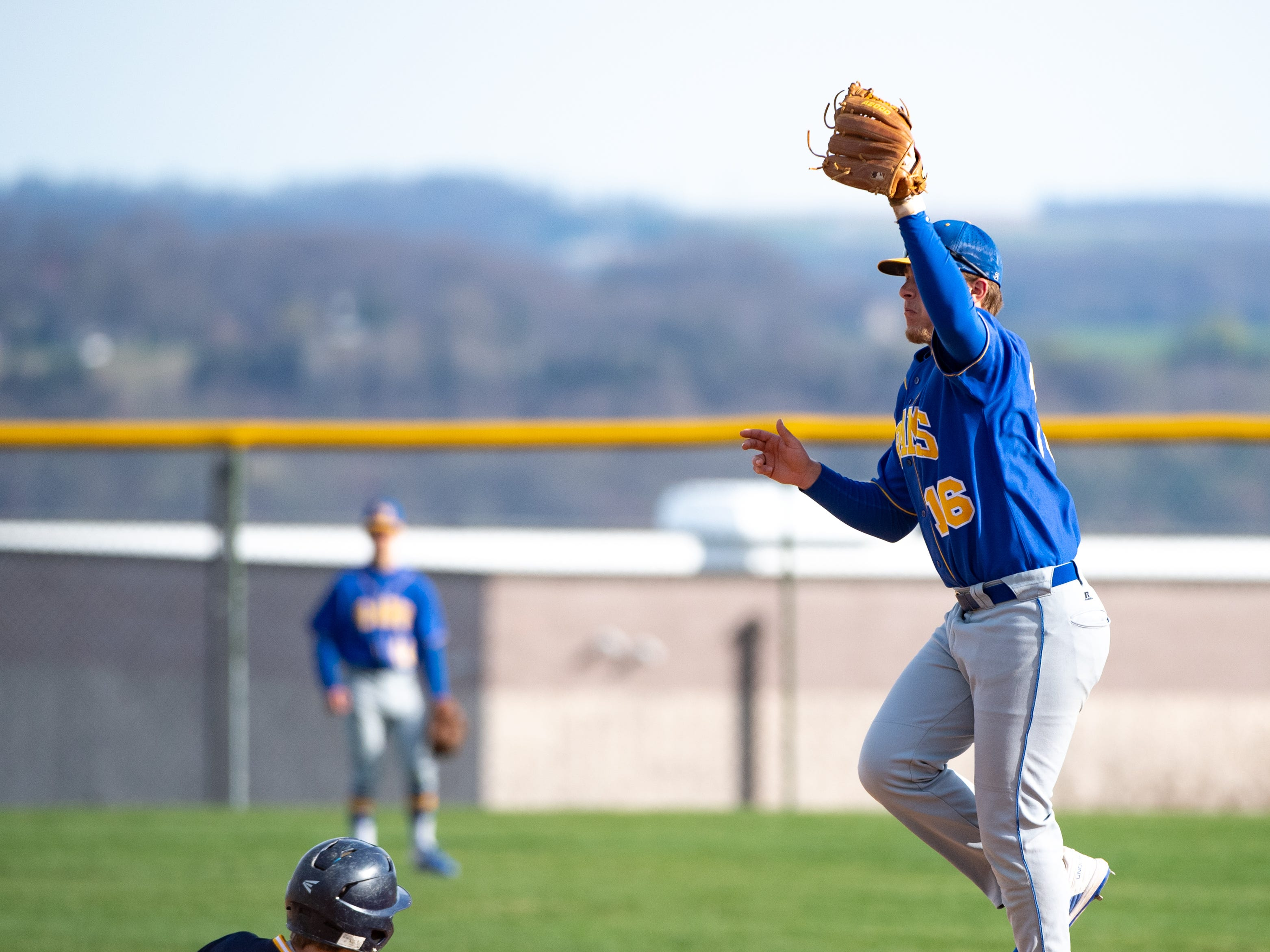 Wyatt McCleary (16) catches the ball as Jacob Bardo (33) slides to second base during the baseball game between Eastern York and Kennard-Dale, April 10, 2019 at Eastern York High School. The Golden Knights defeated the Rams 8 to 1.