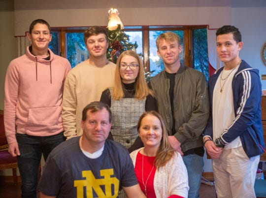 The Bills family poses for a photos this past Christmas with international students Ivan Vuckovic and Neco Velasco Lopez. Front row from left: Ed Bills and Terry Bills. Back row from left: Ivan Vuckovic, Ben Bills, Annabel Bills, Edward Bills, Neco Velasco Lopez.