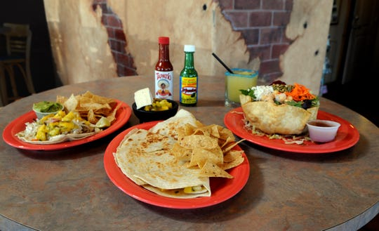 A sweep of dishes at Buenos Grill in Mayberry Landing features a Buenos taco filled with charbroiled fish, mango salsa and citrus honey butter; a brie and mango quesadilla; and a Mexicana salad.
