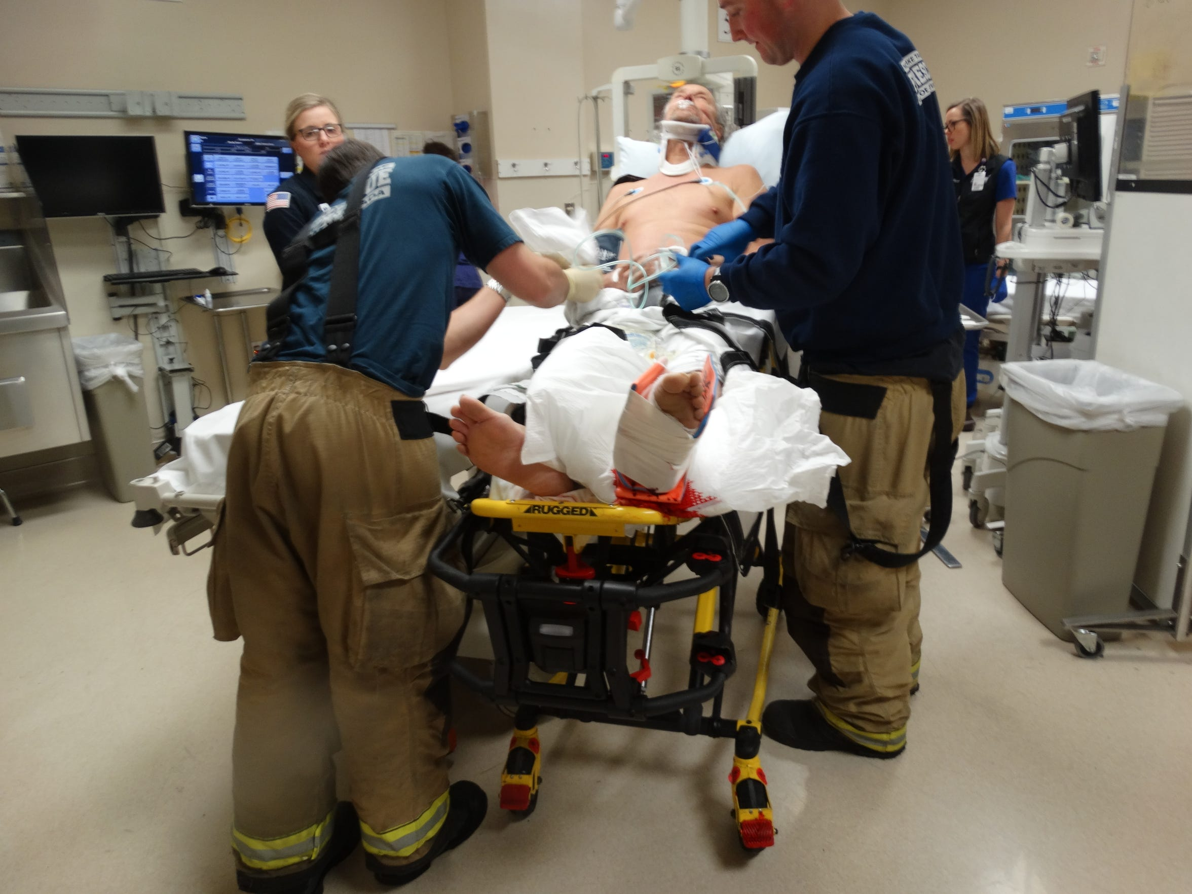 Alan McMann on a gurney in Renown Regional Medical center shortly after being struck by the plow on March 22, 2018. The force of the impact shot the left-front leaf springs of his '78 Chevrolet pickup through the floor of the cab and mangled his left foot, nearly tearing it off.