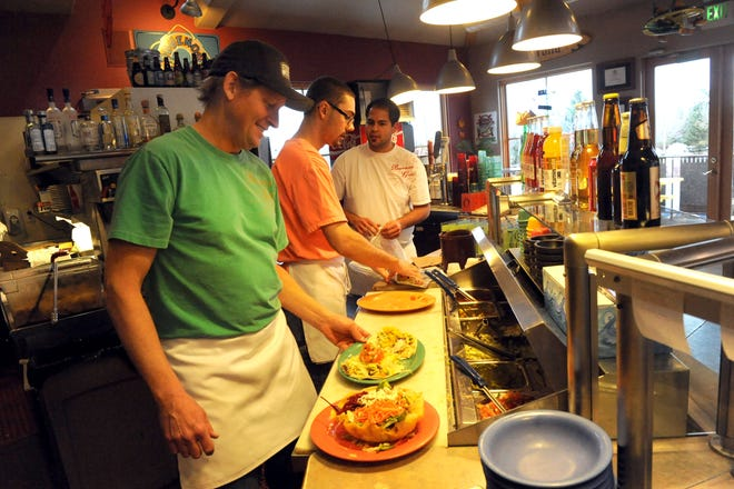 Greg Butler, left, and his wife Mimi opened Buenos Grill in 1999. The restaurant is known for its fish tacos and a lighter take on Mexican dishes.
