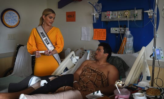 The reigning Miss USA Sarah Rose Summers, of Nebraska, visits with Elijah Roberge at the Renown Children's Hospital in Reno on April 11, 2019. Summers works as a child life specialist.