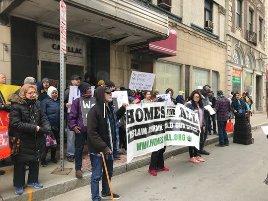 Protesters rally in front of the Hotel Cadillac on April 11, 2019.