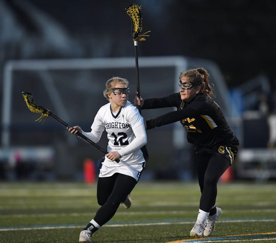 Brighton's Megan Marangola, left, is defended by HF-L's Emma Calcagni during a game at Brighton High School, Wednesday, April 10, 2019.