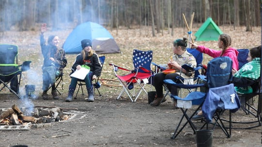 Troop 425 is a multi-grade, all girl-troop with Scouts BSA, a program of Boy Scouts of America. Lilyan Short,11, Elayne Pekurny,11, Dani Phillips, Ellie Nonkes,13, and Eliza Drum talk around the firepit while eating their dinner two other troop members made.