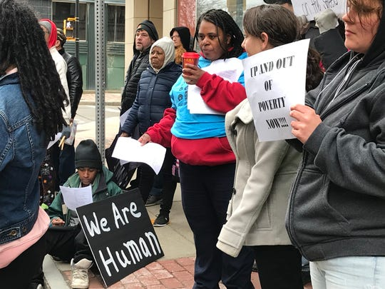 Members of the Housing Coalition rally at the Hotel Cadillac on April 11, 2019.