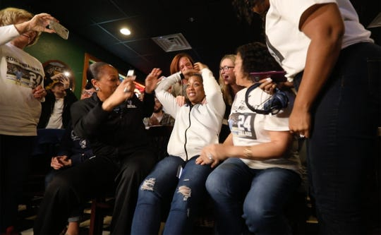 Cierra Dillard reacts to the announcement that the WNBA's Minnesota Lynx picked her in the draft as people around her scream.  About to hug her is her University of Buffalo Basketball Head Coach Felisha Legette-Jack, left, and Dillard's mother, Cheryl Rose.
