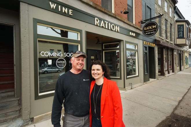 Bruce and Jacquie Billings pose in front of Ration Wine Bar in Perry.
