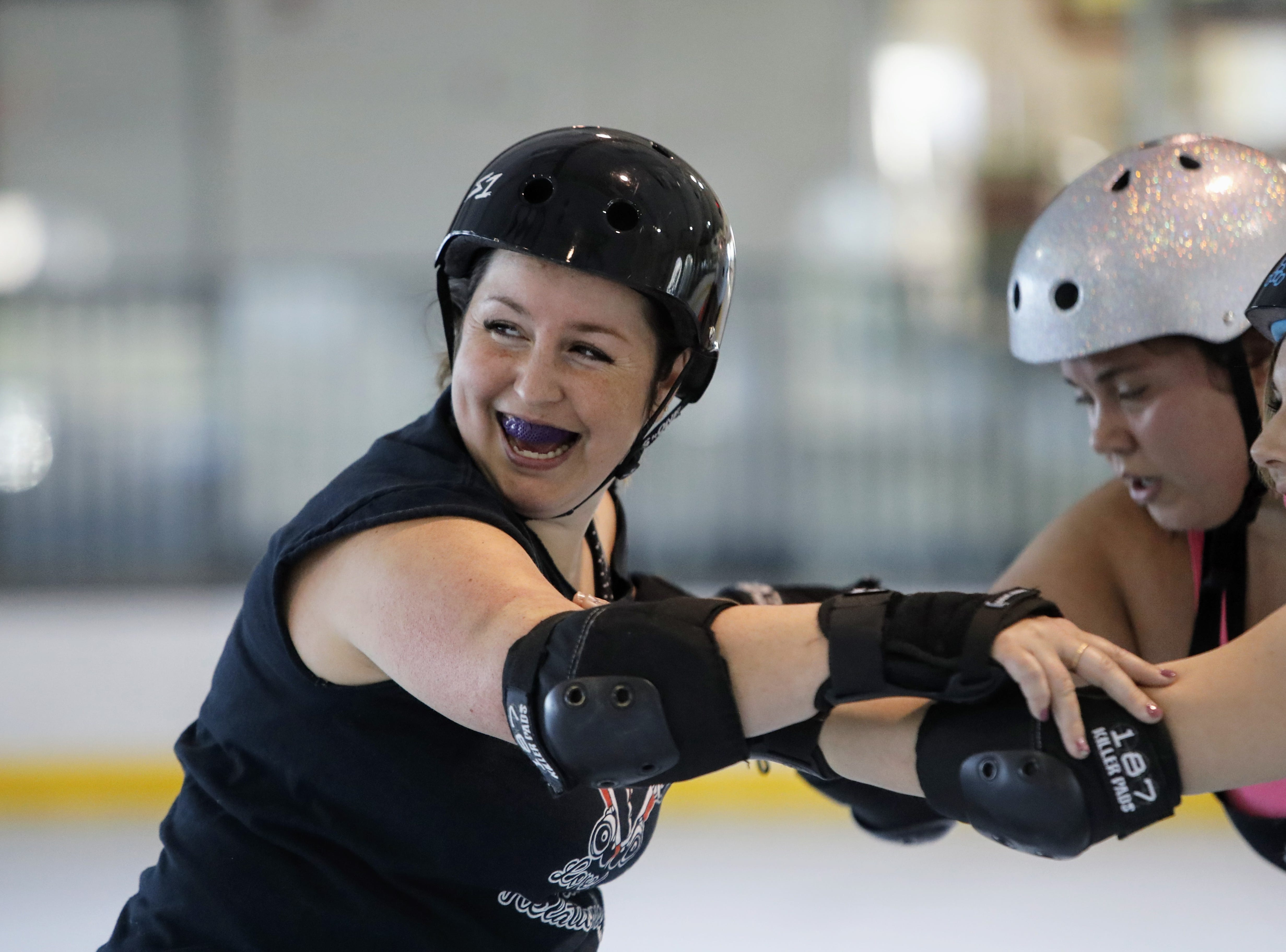 Amanda Harter (left), who goes by the skater nickname Swift D. Mize, participates in a drill during a Shasta Roller Derby practice at Big League Dreams in Redding on Wednesday, April 10.