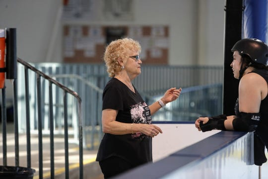 """Judy Arnold (left), who is in roller derby's Hall of Fame, talks to Danae """"Wrecking Doll"""" Villarreal at a Shasta Roller Derby practice at Big League Dreams in Redding on Wednesday, April 10."""