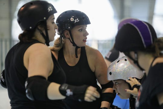Alecia Barnett (center), who goes by the skater name Mama Smackdown, waits for the starting whistle to blow at a  Shasta Roller Derby practice at Big League Dreams in Redding on Wednesday, April 10.