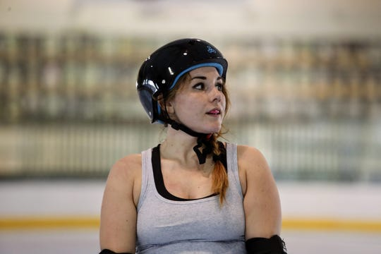 Kadee Strait, who goes by the skater name Rambi Rhino, listens to a coach give instructions at a Shasta Roller Derby practice at Big League Dreams in Redding on Wednesday, April 10.