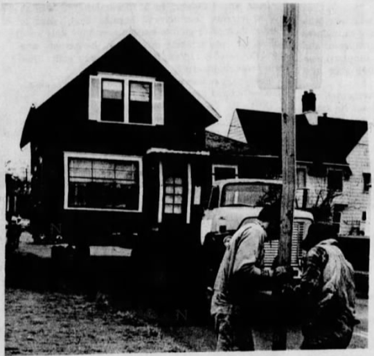 Barbara Carey and Ken Bonnem found moving their house a larger task than they had anticipated. In this photo from a February 1983 edition of the Statesman Journal, workers remove a road sign to make way for the house.