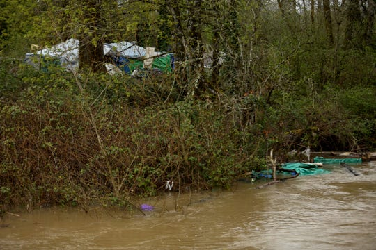 Tents and other belongings are under water at a homeless camp as Wallace Marine Park floods near the Willamette River in West Salem on April 10, 2019.