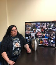 Rita Cardona with the ashes and photos of her husband Phillip Rivera.