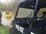 Emergency personnel rescue from a homeless camp as Wallace Marine Park floods near the Willamette River in West Salem on April 10, 2019.