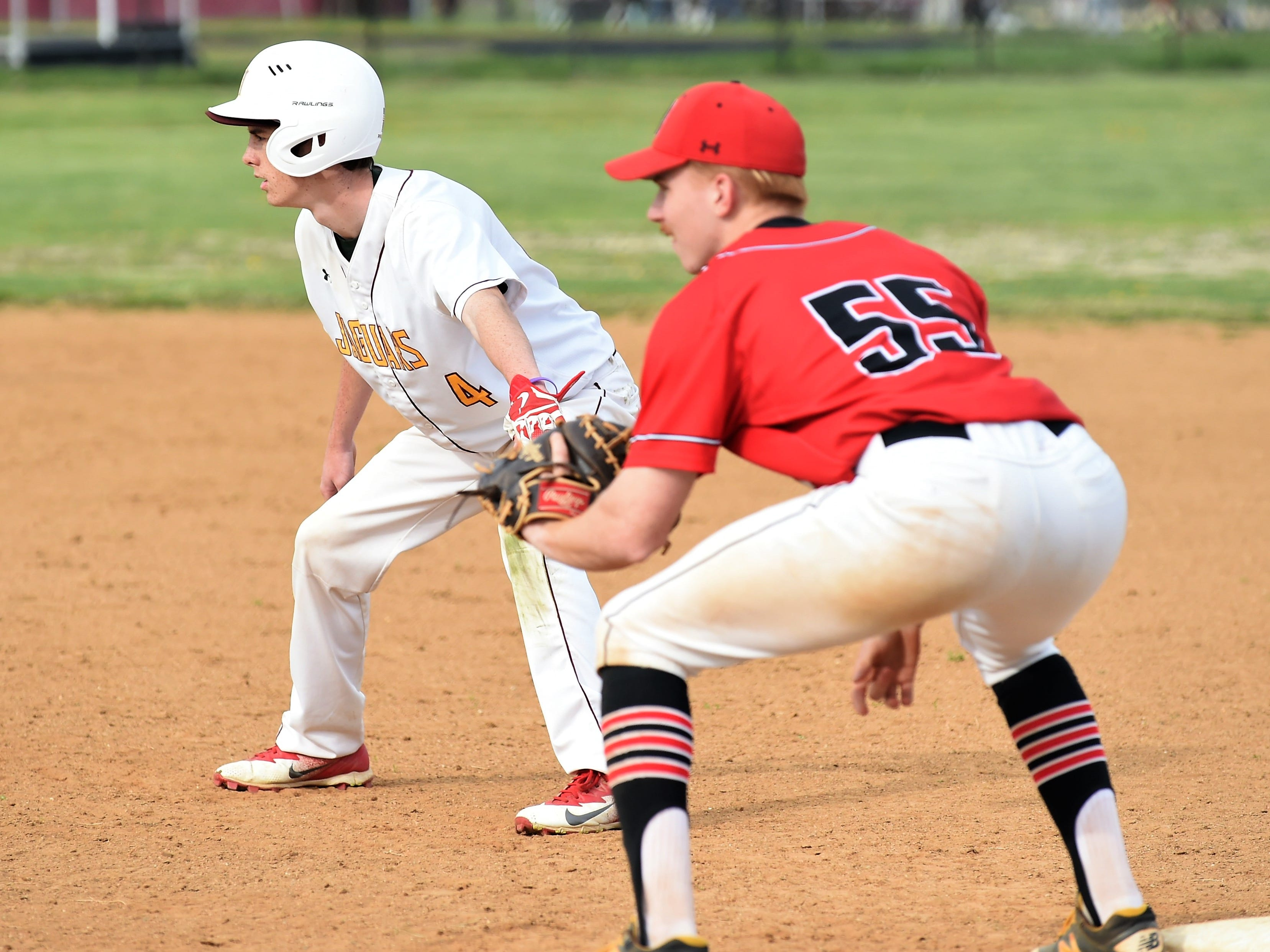 Washington outfielder Ryan Hungerford leads off as James M. Bennett's Max Taylor looks to the mound on Thursday, April 11, 2019. JMB won, 13-2.