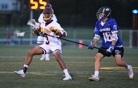 Salisbury University's Zach Pompea with the ball against Christoper Newport on Wednesday, April 10, 2019.
