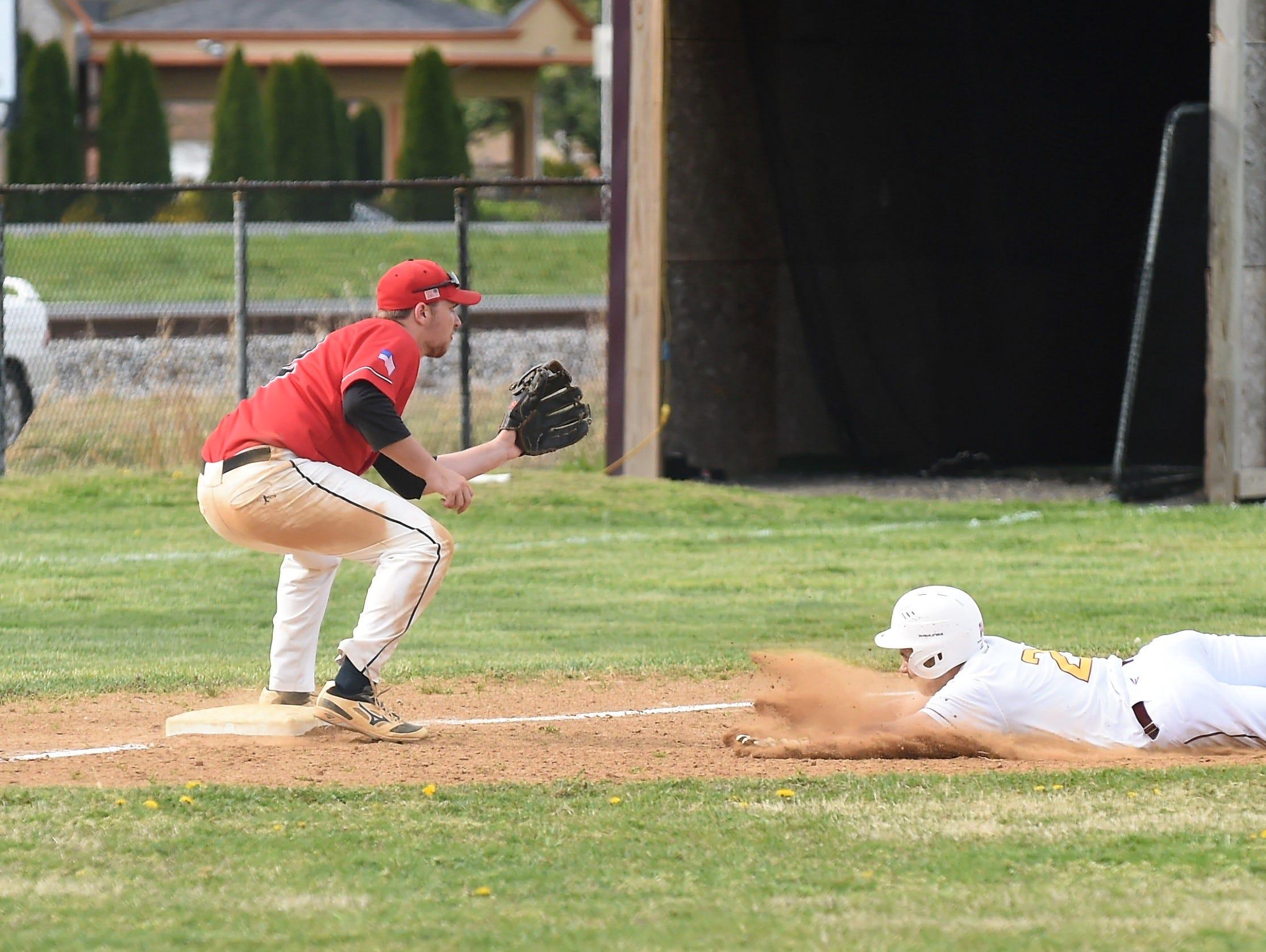 James M. Bennett third baseman Brett Swift looks for the throw as a Washington player slides into third on Thursday, April 11, 2019. JMB won, 13-2.