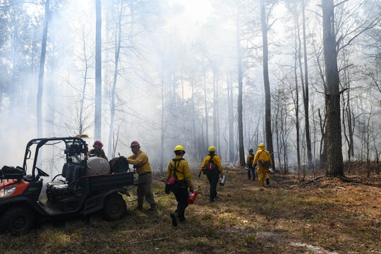 A team from The Nature Conservancy and the Maryland Department for Natural Resources manages a planned burn in the Nassawango Creek Preserve near Salisbury on Thursday, April 11, 2019. Controlled fires help restore native vegetation and reduce wildfire risk, scientists say.