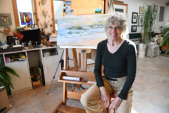 Nancy Richards West in her studio located in Chincoteague, Va. She will have her oil paintings on sale at the 40th Easter Decoy and Art Festival on April 19-20.
