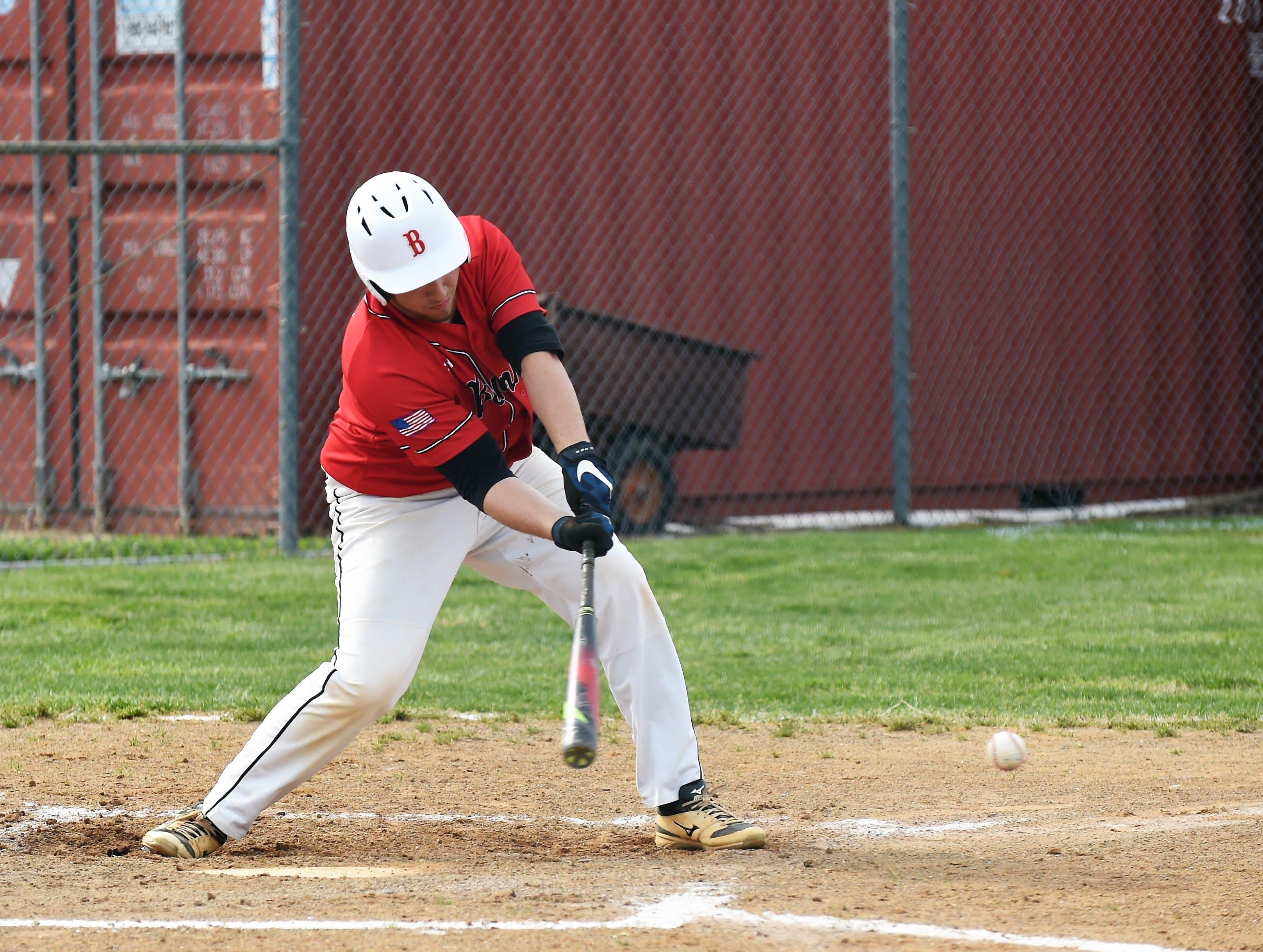 James M. Bennett third baseman Brett Swift swings the bat against Washington on Thursday, April 11, 2019. JMB won, 13-2.