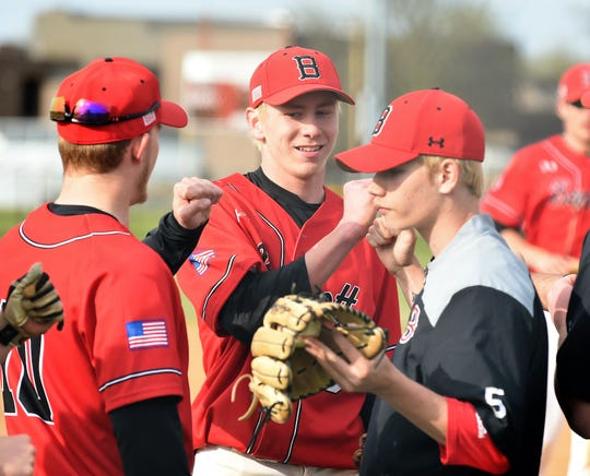 James M. Bennett pitcher Ryan Mitchell is congratulated by teammates after an inning against Washington on Thursday, April 11, 2019. JMB won, 13-2.