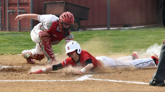 James M. Bennett outfielder Anders Brown slides into home against Washington on Thursday, April 11, 2019. JMB won, 13-2.