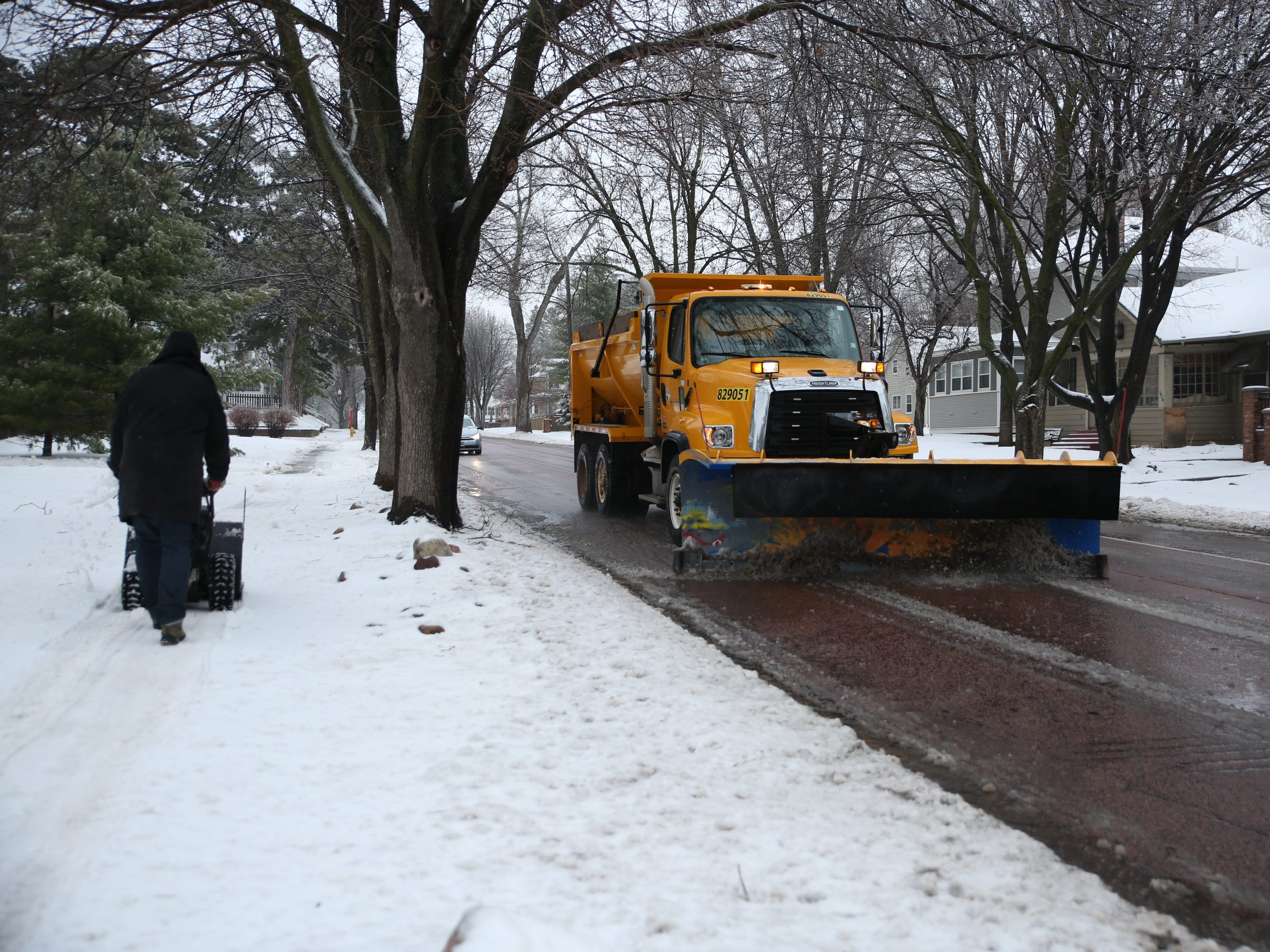 A snow plow runs through Phillips Avenue in Sioux Falls on Thursday, April 11 after a spring blizzard. The blizzard featured rain, sleet, snow and ice.