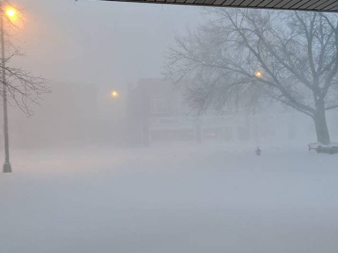 Snow in uptown Watertown, South Dakota during a blizzard on Thursday, April 11, 2019.