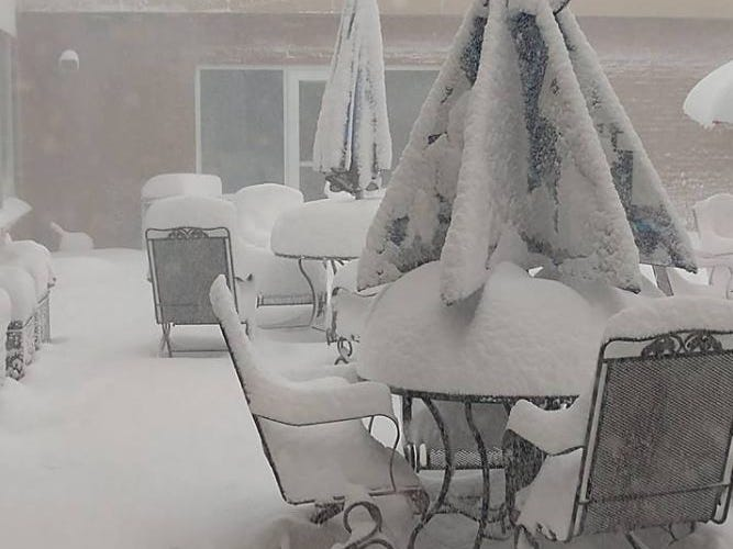 Patio furniture covered with snow in Mitchell, South Dakota during a blizzard on Thursday, April 11, 2019.