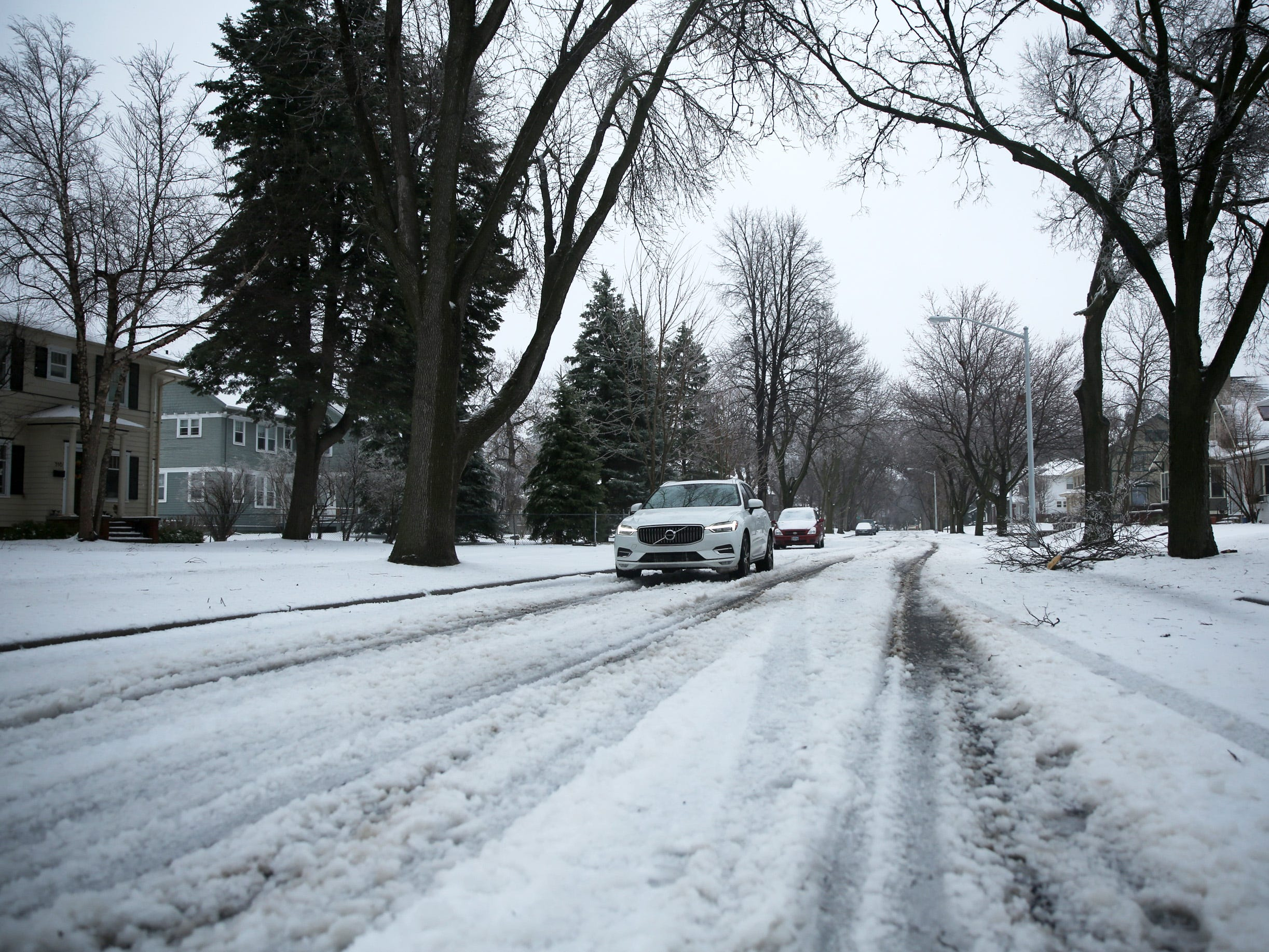 A vehicle drives through slush on residential roads in Sioux Falls on Thursday, April 11. Rain, sleet, snow and ice fell in the region as a winter storm system moved through South Dakota.